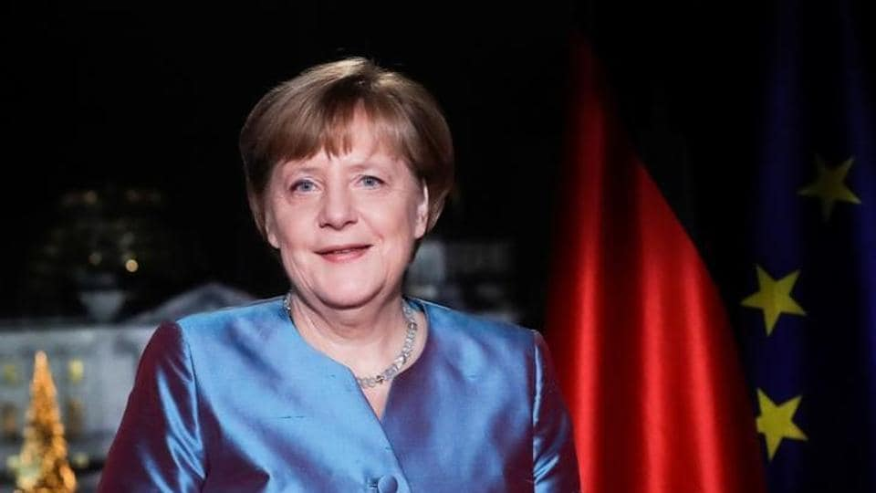Chancellor Angela Merkel poses for photographs after the television recording of her annual New Year's speech at the Chancellery in Berlin, Germany, on December 30, 2016.