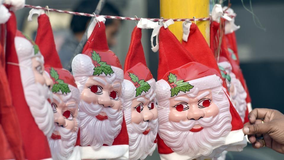 Santa Claus hats and masks on display at a roadside in Amritsar.