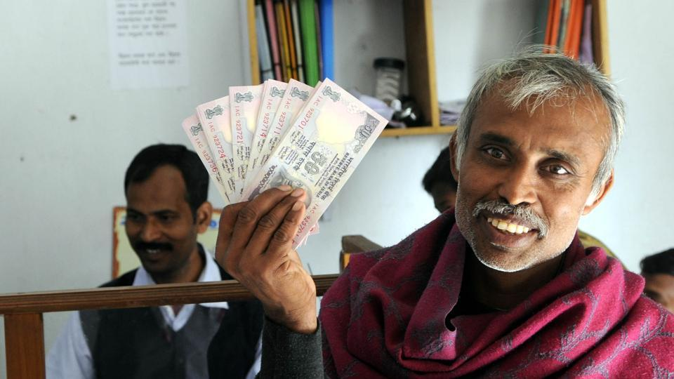 A man shows Rs 50 notes at  Luxbagan of Satjelia in Sunderbans, West Bengal.