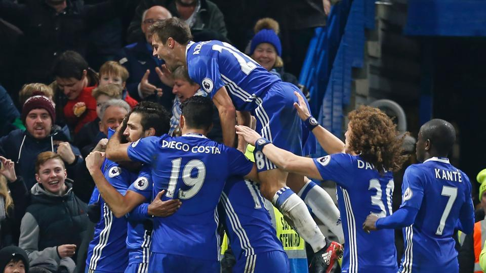Chelsea's Brazilian midfielder Willian celebrates with teammates after scoring their third goal during their Premier League  match.