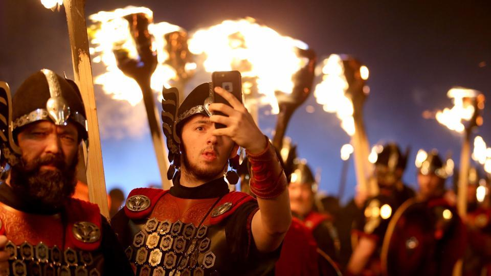 """Entering 2017, but first lemme take a selfie"": A member of Shetland's Up Helly Aa' Vikings clicks a selfie, dressed to lead the opening event of Edinburgh's Hogmanay (New Year) celebrations with the traditional Torchlight Procession in Edinburgh, Scotland, on Friday.  (AP)"