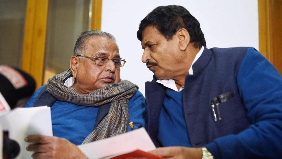 Samajwadi Party supremo Mulayam Singh Yadav and party's UP president Shivpal Singh Yadav during the expulsion announcement of CM Akhilesh Yadav and Ram Gopal Yadav, in Lucknow on Friday.