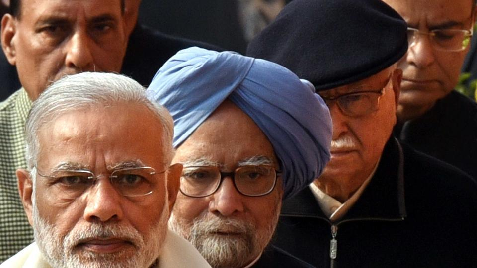 In this photo taken on December 13, 2016, Prime Minister Narendra Modi, former PM Manmohan Singh, BJP Leader LK  Advani, home minister Rajnath Singh, finance ministArun Jaitley and Congress leader Ghulam Nabi Azad arrive at Parliament House to pay tribute to martyrs who sacrificed their lives during the 2001 Indian Parliament terrorist attack. The image went viral across websites.