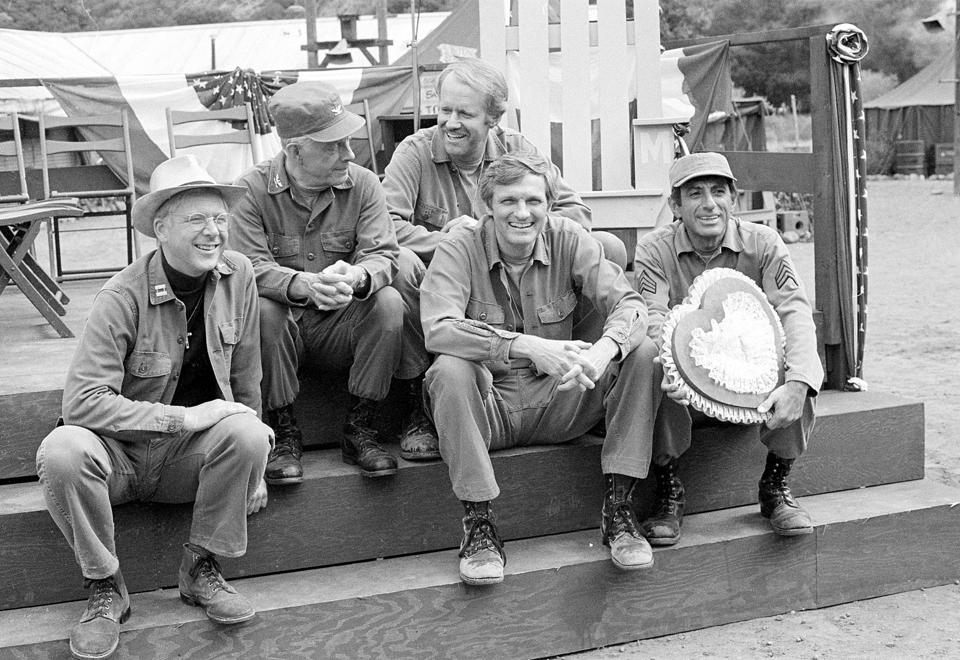 In this Sept. 15, 1982, file photo, cast members of the television series take a break on the set during taping in Los Angeles. (L-R) William Christopher, Harry Morgan, Mike Farrell, Alan Alda, and Jamie Farr. Christopher died Saturday.