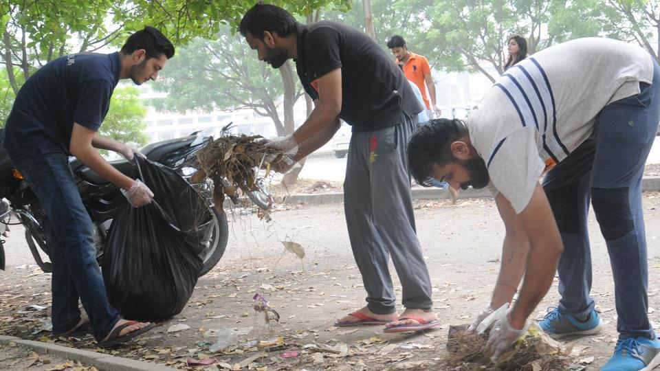 Students cleaning the Panjab University campus in Chandigarh.
