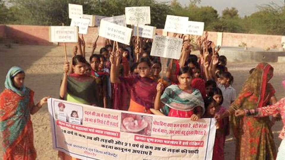 Children take part in a rally in Rajasthan to create awareness against child marriage.