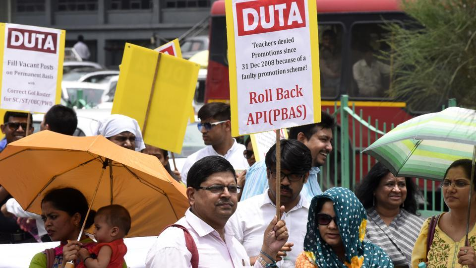 """The ad-hoc teachers of Delhi University have demanded """"absorption"""", as they say, the appointment and promotion rules adopted by the universities statutory body is against them."""