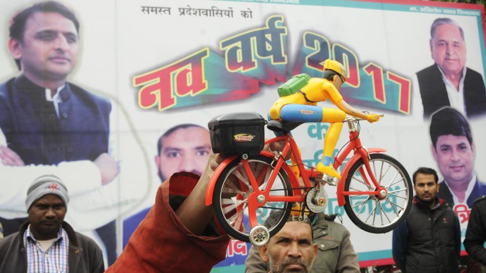 Samajwadi party supporters holding the a toy bicycle which is the party symbol, outside Mulayam Singh's residence in Lucknow, on January 1.