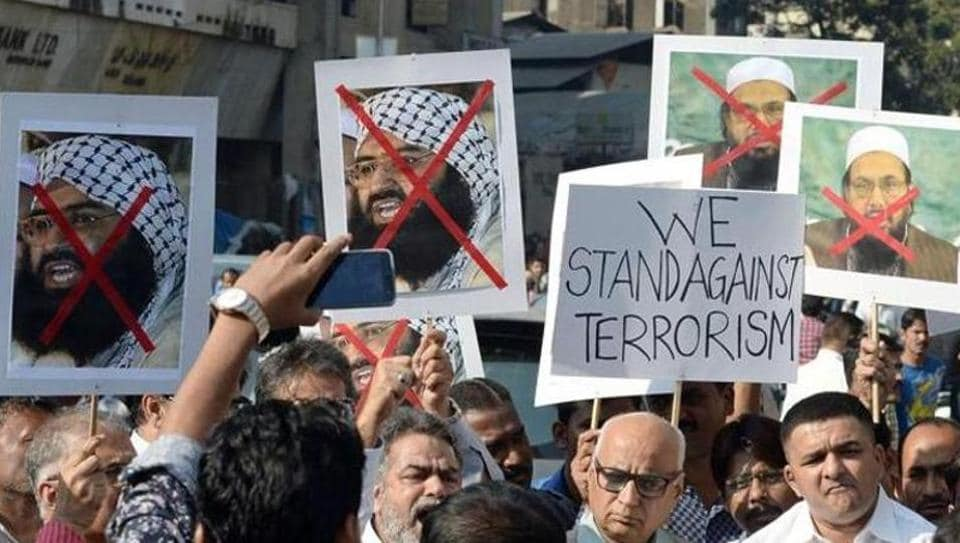 Activists protest against the chief of Jaish-e-Mohammad, Maulana Masood Azhar (left placard) and chief of Pakistan's outlawed Islamic hardline Jamaat ud Dawa (JD), Hafiz Mohammad Saeed (right placard) in Mumbai in January 2016 immediately after the attack on the Pathankot airbase.