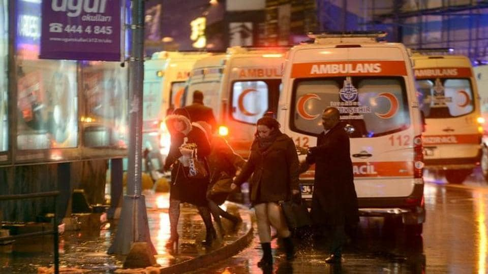 People run away from a nightclub where a gun attack took place during a New Year party in Istanbul.