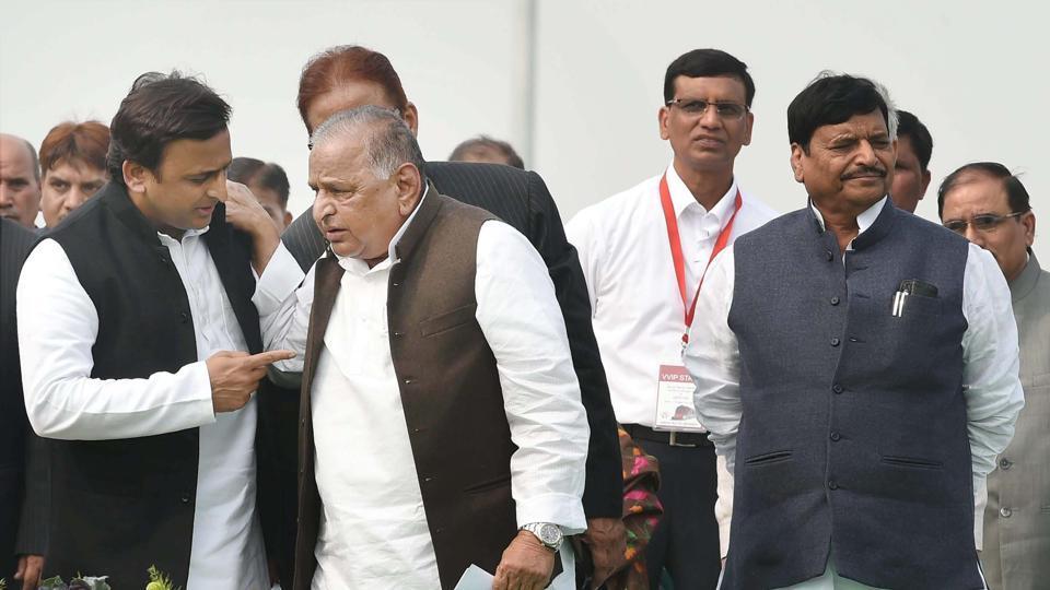 Samajwadi Party supremo Mulayam Singh Yadav, Uttar Pradesh CM Akhilesh Yadav and SP's UP chief Shivpal Singh Yadav during a function to start the trial run of Lucknow Metro in Lucknow on December 1.