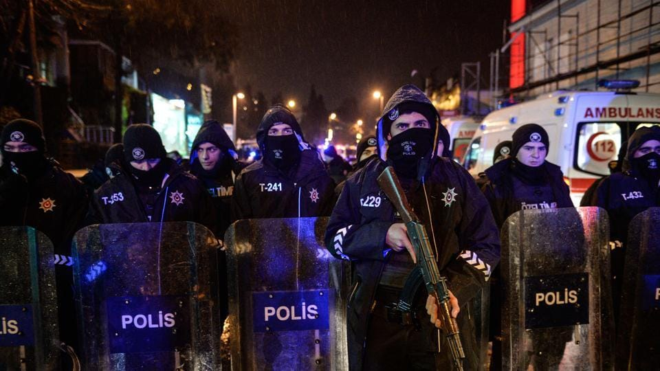 Turkish police officers block the road leading to the scene of an attack in Istanbul, early Sunday, January 1, 2017. An assailant believed to have been dressed in a Santa Claus costume and armed with a long-barrelled weapon, opened fire at a nightclub in Istanbul's Ortakoy district.