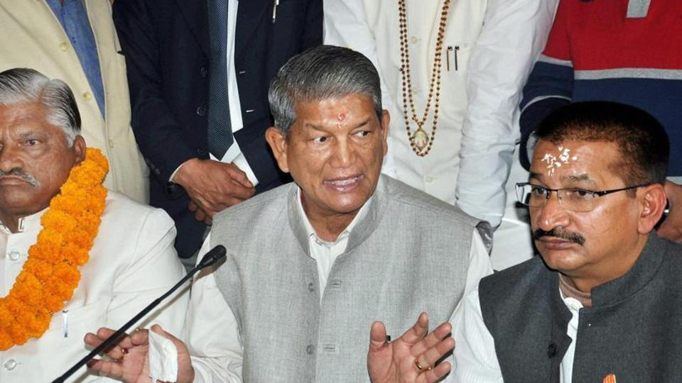 Chief minister Harish Rawat addresses a press conference in Dehradun on Monday with Congress state unit president Kishore Upadhyay (right).