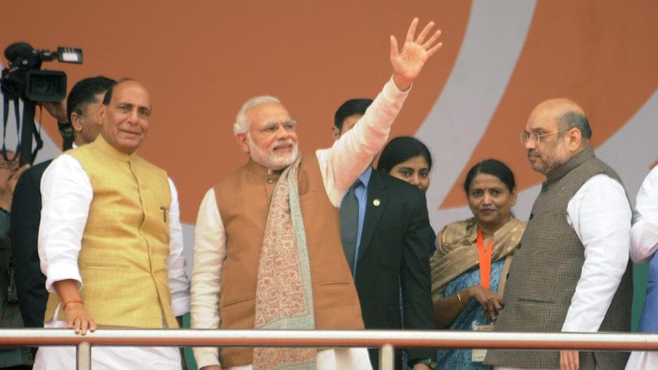 Prime Minister Narendra Modi and other senior BJP leaders wave to the crowd during their Parivartan Rally at Ramabai Ambedkar ground in Lucknow.