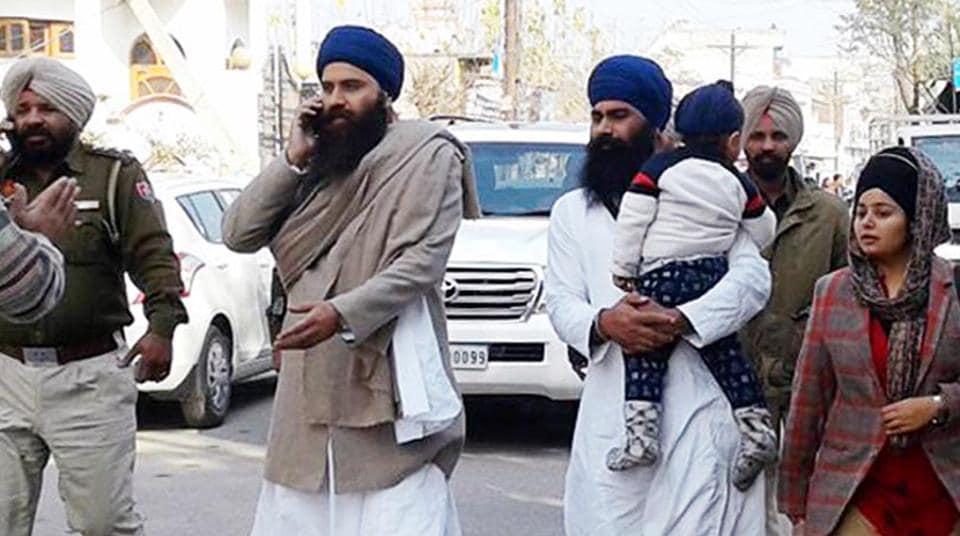 Parallel jathedar Baljit Singh Daduwal (second from left) in police custody at Qadian on Sunday.