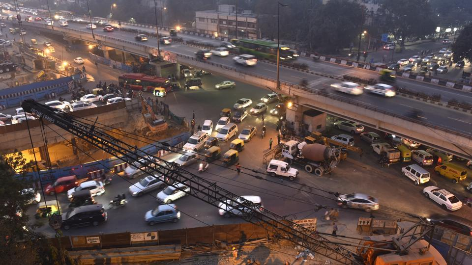 Roads dug up for Metro construction, constant road repair, lack of ample traffic officials to man traffic, and illegal parking on the roadside are major reasons behind congestion at Ashram Chowk.