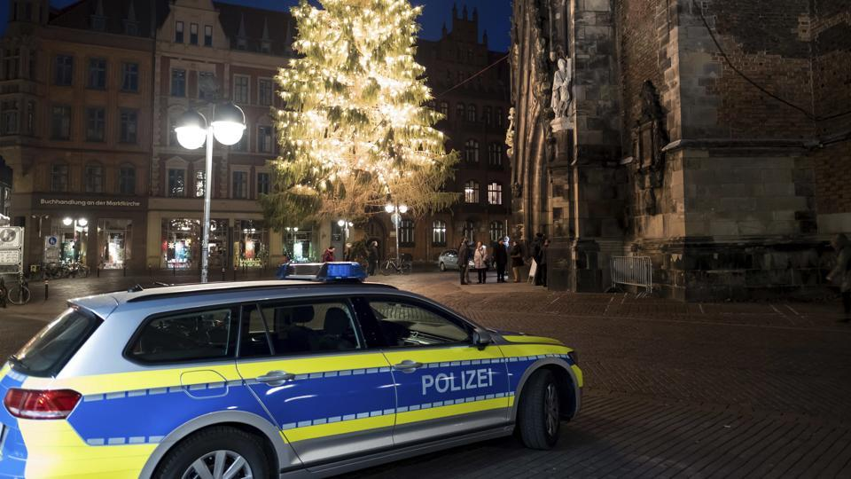 A police car stands near the Market Church in Hannover, Germany.