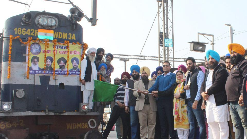 Deputy commissioner Basant Garg flags off special train for pilgrims to pay obeisance at Takht Patna Sahib for 350th birth anniversary celebrations of Sri Guru Gobind Singh Ji at railway station, Amritsar on Monday.