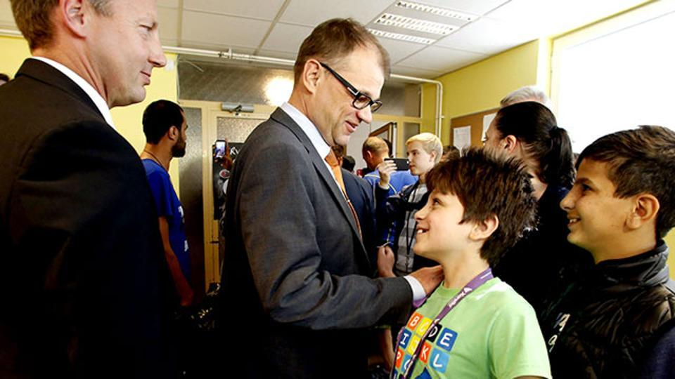 Finland's Prime Minister Juha Sipila visits a reception centre in Oulu, Northern Finland.