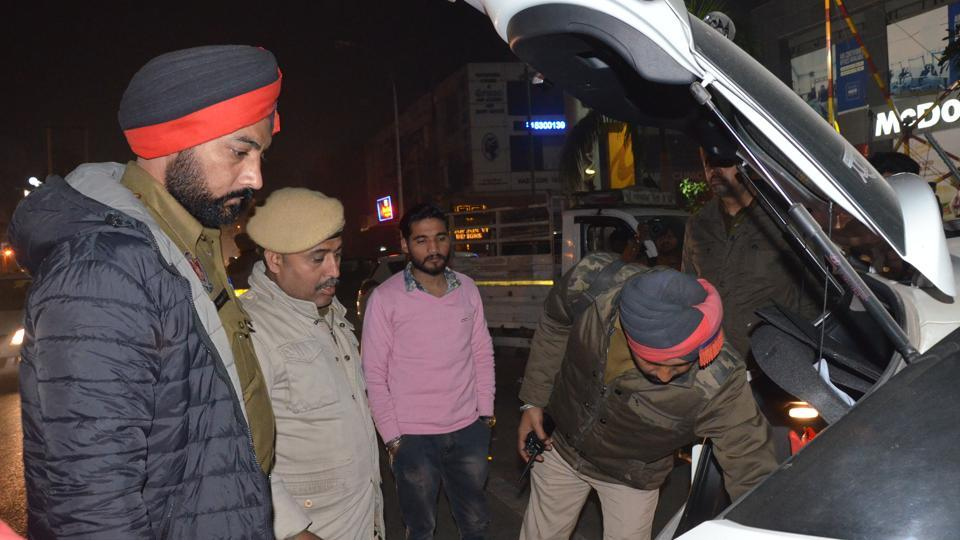 Police checking a vehicle during the New Year celebrations in Ludhiana on Saturday evening.