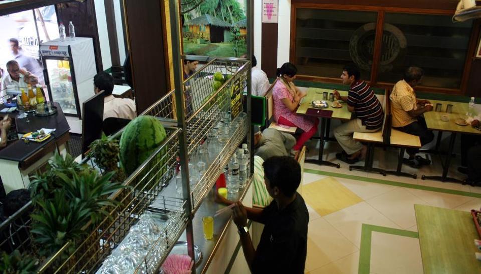People enjoy their food at a restaurant in Mumbai.