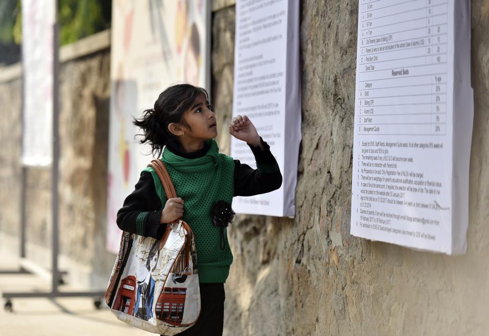 Unaware of the different eligibility criteria for sought-after schools, parents and children lined up outside campuses early on Monday morning.