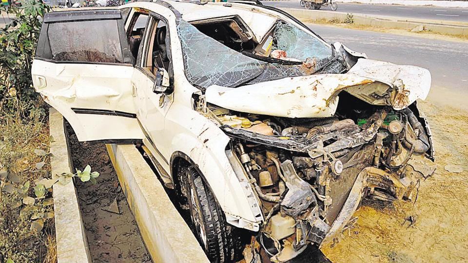 The remains of the car that hit streetlight pole in Noida Extension on Monday night.
