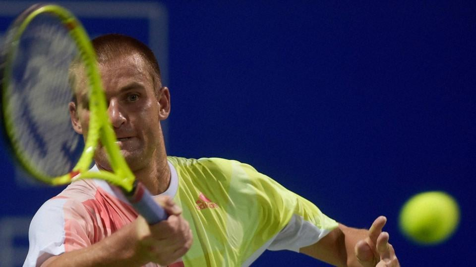 Mikhail Youzhny (RUS) in action against Saketh Myneni (IND) during their first round match for the ATP Chennai Open 2017.