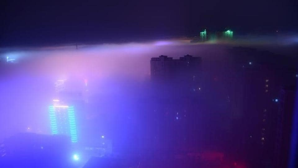 Buildings are seen in the fog in Yancheng, Jiangsu province, China. (Reuters)