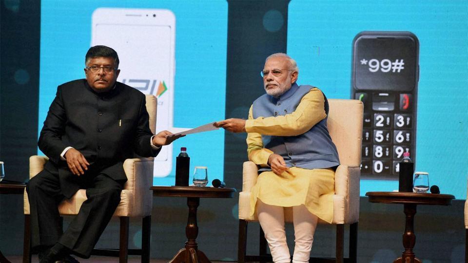 PM Narendra Modi and Union minister Ravi Shanker Prasad at the launch of mobile app 'Bhim' at Talkatora Stadium in New Delhi.