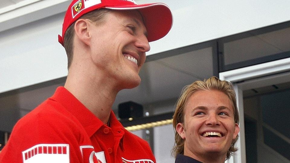 In this picture taken on April 20, 2006 Ferrari driver Michael Schumacher, left, of Germany, and fellow-countryman Nico Rosberg, of Williams, talk at the Dino and Enzo Ferrari racetrack in Imola, Italy.