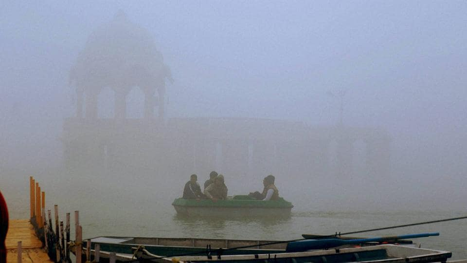 Jaisalmer: A view of a lake during a foggy morning in Jaisalmer, Rajasthan. (PTI)