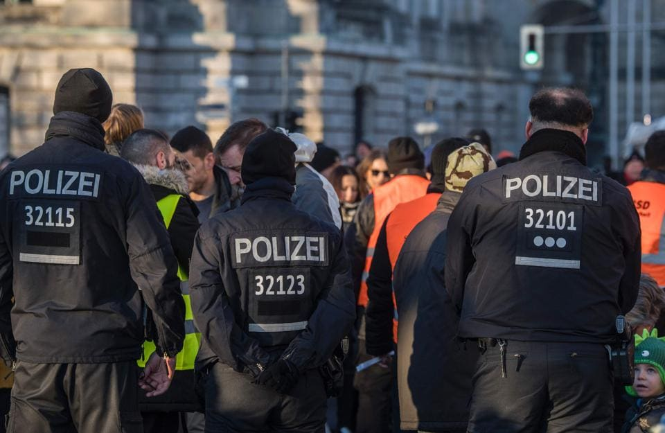 German police officers watch over a security check near the capital's Brandenburg Gate.