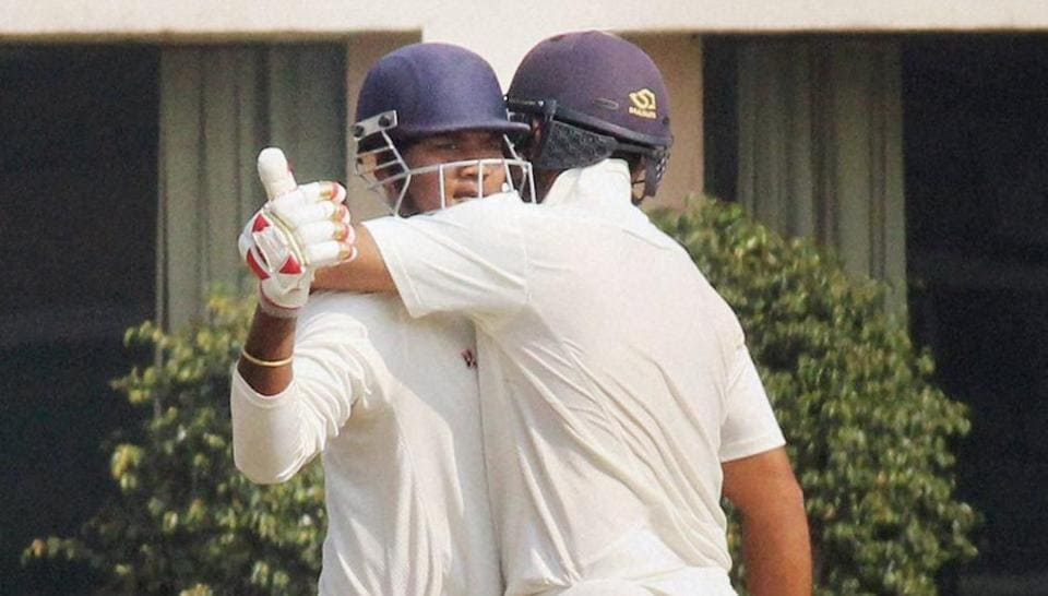 Jharkhand batsman Ishank Jaggi congratulates Kaushal Singh for completing his century against Gujarat during the Ranji Trophy semifinal match.