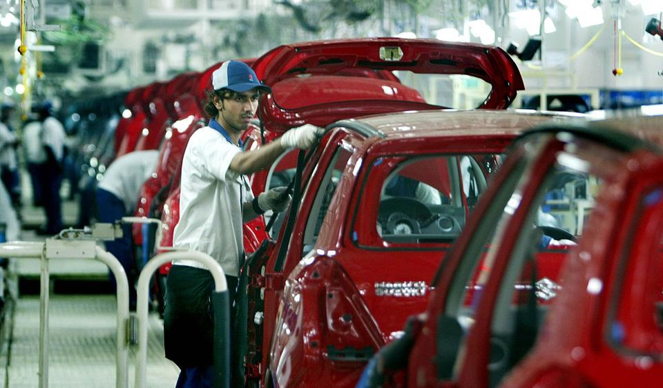 The Maruti Suzuki Swift, seen here in an assembly line, is one of the best cars in India under Rs 5 lakh.