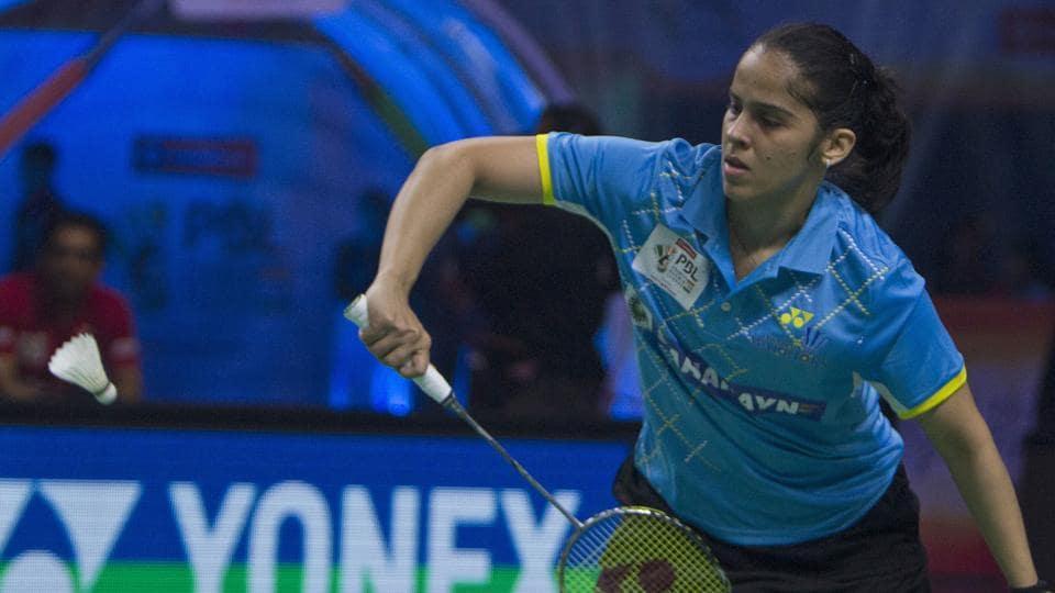 Saina Nehwal of Awadhe Warriors returns a shot to Spanish player Carolina Marin of Hyderabad Hunters during the women's singles of Premier Badminton League (PBL) in Hyderabad.