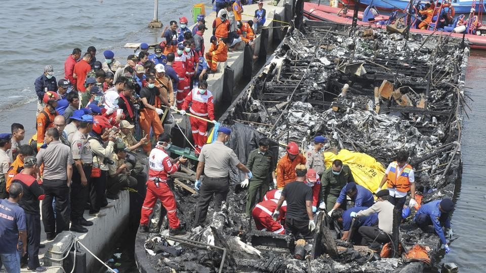 Rescuers search for victims from the wreckage of a ferry that caught fire off the coast of Jakarta after it was docked at Muara Angke Port in Jakarta, Indonesia on Sunday.