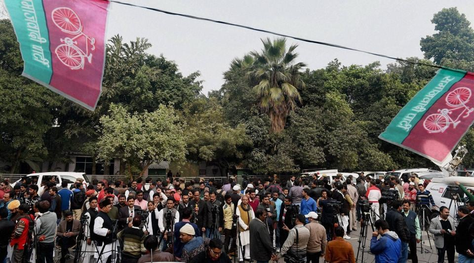 Mediapersons and SP workers stand outside Mulayam Singh Yadav's residence in Lucknow, as Uttar Pradesh CM Akhilesh Yadav met with his father amid speculations of reconciliation in the Yadav family .