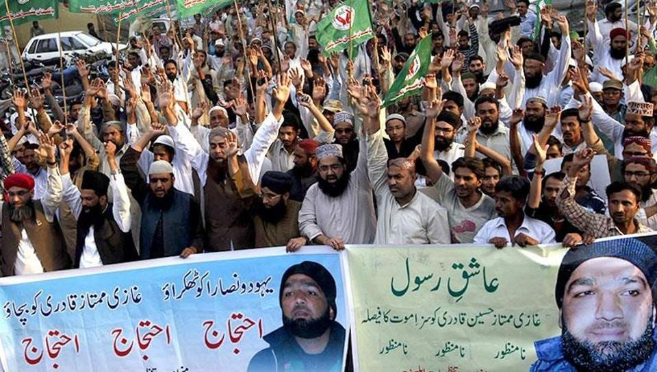 In this March 2015 file photo, supporters of a religious political party shout slogans during a demonstration against the sentence of convicted killer Mumtaz Qadri in Karachi. He killed Punjab governor Salman Taseer because he championed the case of a Christian woman, Asia Bibi, who was sentenced to death under the blasphemy laws.