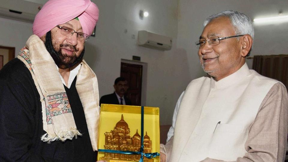Bihar CM Nitish Kumar (right) presents a memento to Punjab Congress chief Capt Amarinder Singh in Patna on Tuesday.