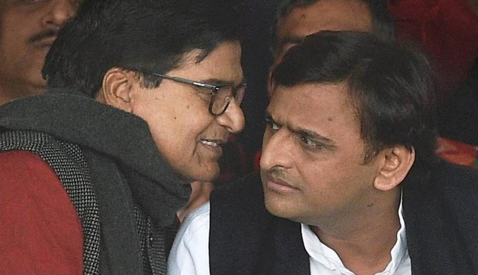 Uttar Pradesh Chief Minister and newly unanimously elected party's national president Akhilesh Yadav and SP general secretary Ram Gopal Yadav during Samajwadi party national convention in Lucknow on Sunday.