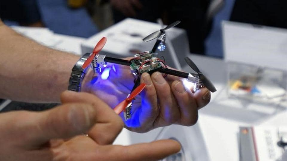 A vendor demonstrates the Micro Drone for a prospective retailer at the International Consumer Electronics show (CES) in Las Vegas, Nevada.