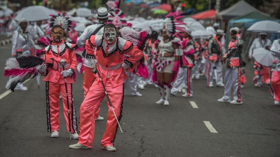 People in disguise join the traditional Second New Year Parade. The festival is considered as a rite of renewal that has been shaped by the Cape's history.  (Mujahid Safodien/AFP)