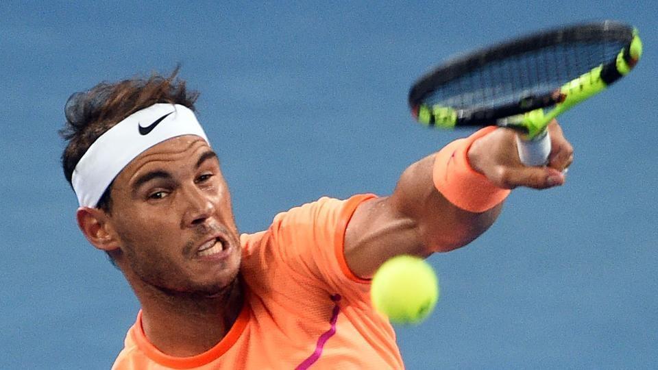 Rafael Nadal of Spain serves against Alexandr Dolgopolov of Ukraine in the men's round one at the Brisbane International.