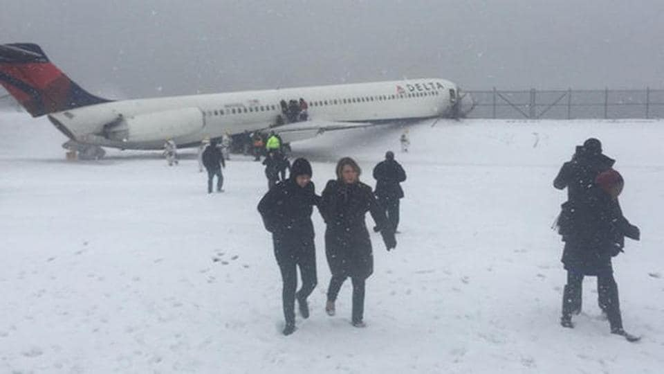 A Russian passenger plane skidded off the runway after landing in snowy conditions at Kaliningrad airport, authorities said Wednesday, with three people suffering minor injuries.