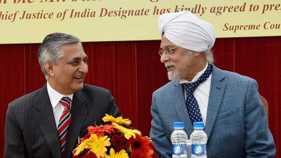 Outgoing Chief Justice of India Justice TS Thakur with CJI-designate Justice JS Khehar at his farewell ceremony in New Delhi on Tuesday.