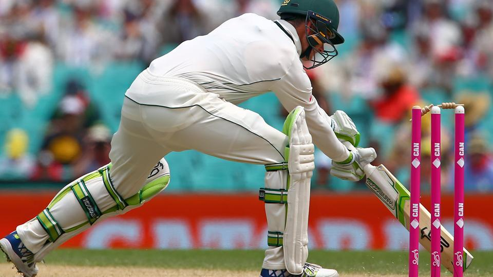 Australia's Peter Handscomb hits his wicket and is given out for 110 runs in the third cricket Test against Pakistan in Sydney.