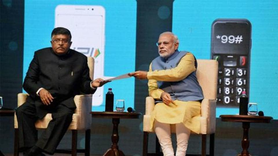 Prime Minister Narendra Modi and Union Minister IT and communications, Ravi Shanker Prasad at the launch of a new mobile app 'Bhim' to encourage e-transactions at Talkatora Stadium in New Delhi.