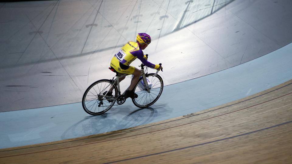 Robert Marchand, aged 105, cycles in a bid to beat his record for distance cycled in one hour, at the velodrome of Saint-Quentin en Yvelines, outside Paris, Wednesday, Jan. 4, 2017.  (Francois Mori / AP)