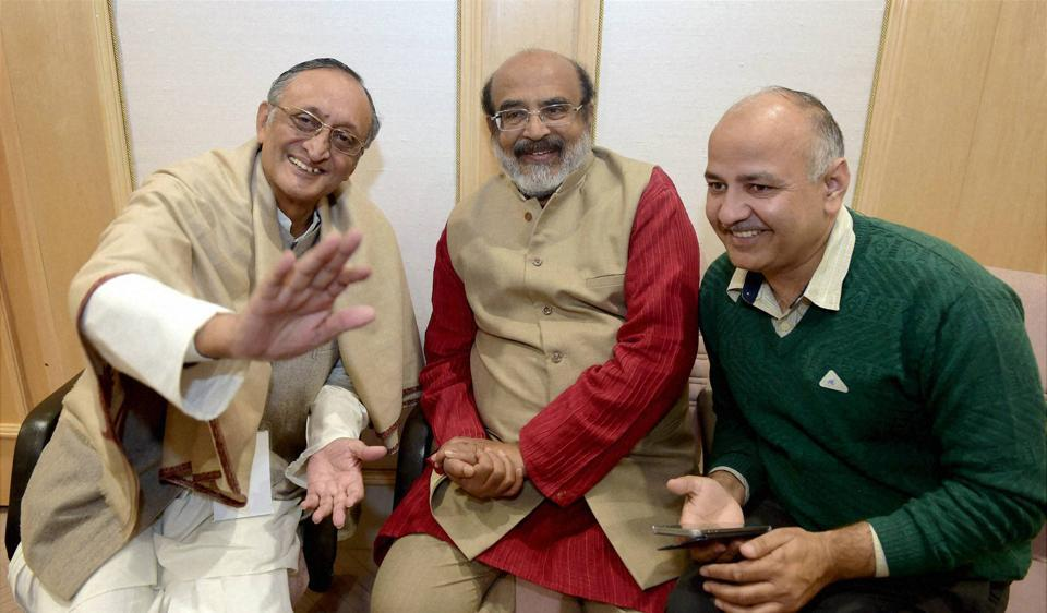 Delhi Finance Minister, Manish Sisodia with Finance Minister of Kerala, T M Thomas Isaac and West Bengal Finance Minister, Amit Mitra before the meeting of the GST Council at Vigyan Bhawan in New Delhi on Tuesday.